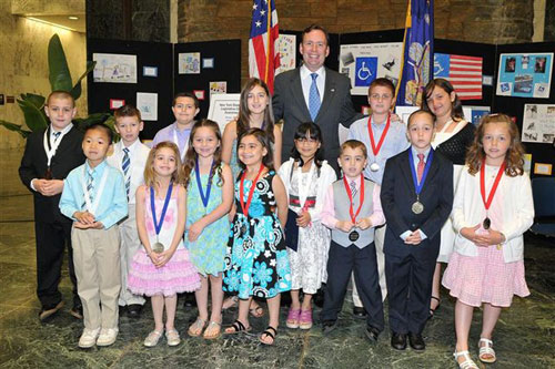 Staten Island student-winners of the 2012 New York State Assembly Legislative Disabilities Awareness Day Poster Contest with Assemblyman Mike Cusick, Chair of the Assembly Task Force.