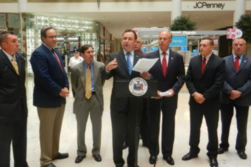 Assemblyman Michael Cusick speaks during the press conference about his Organized Retail Crime Bills with David Albertson from the Staten Island Mall, Ted Potrikus of the New York State Retail Council, Michael Rosen of the Food Industry Alliance, Gold Mine Jewelers shop owner Gerald Amerosi, District Attorney Daniel Donovan, representative from Senator Lanza's office, and a Staten Island Mall retailer.