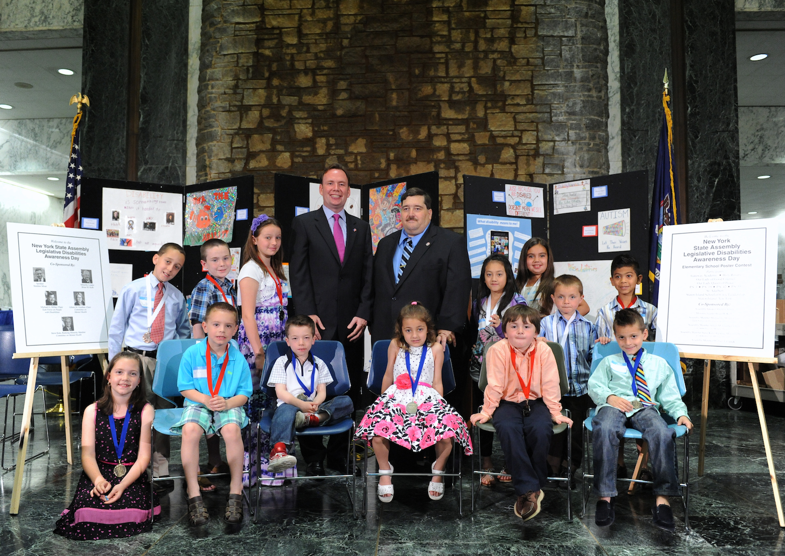 "Assemblyman Mike Cusick, former Chair of the Assembly Task Force on People with Disabilities along with Assemblyman Mike Miller, current Chair, pose with Staten Island students at the State Capital. The students won 1st, 2nd, and 3rd place in a poster contest sponsored by Assemblyman Cusick entitled ""What Disabilities Means to Me"" and were in Albany participating in the Assembly's Disability Awareness Day."