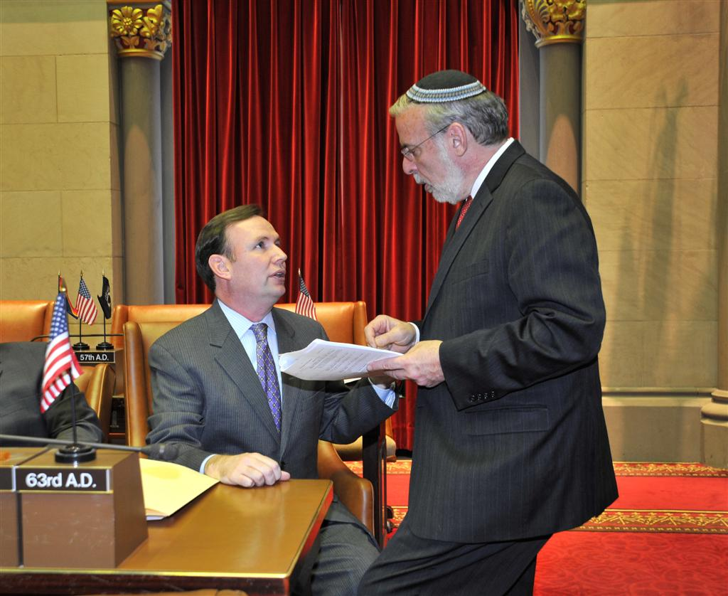 Assemblyman Cusick discusses legislation with Assemblyman Dov Hikind in the Assembly Chamber. -Legislative Session 2014