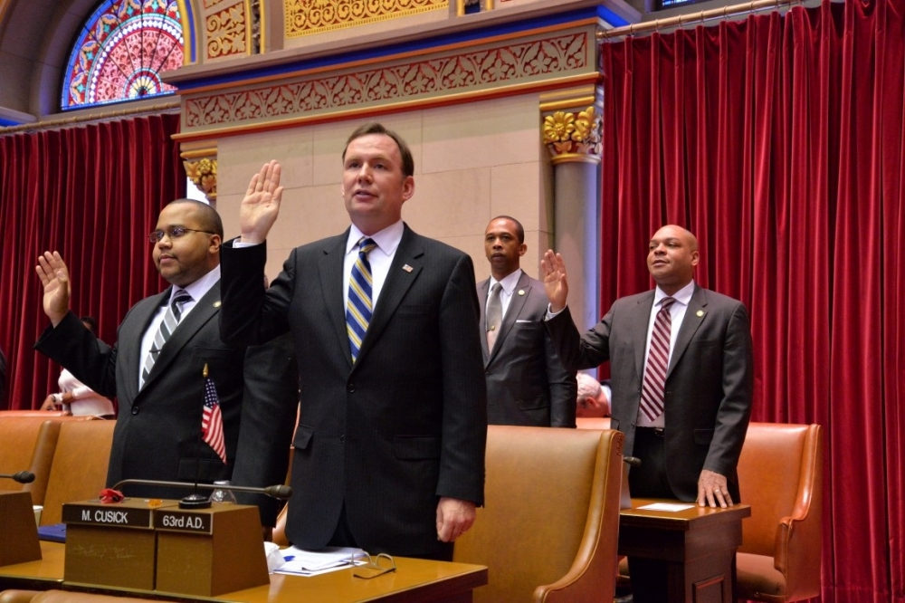 Assemblyman Mike Cusick takes his Oath of Office in the State Capitol on January 7, 2015 for another term as the State Assemblyman for the 63rd Assembly District of Staten Island.