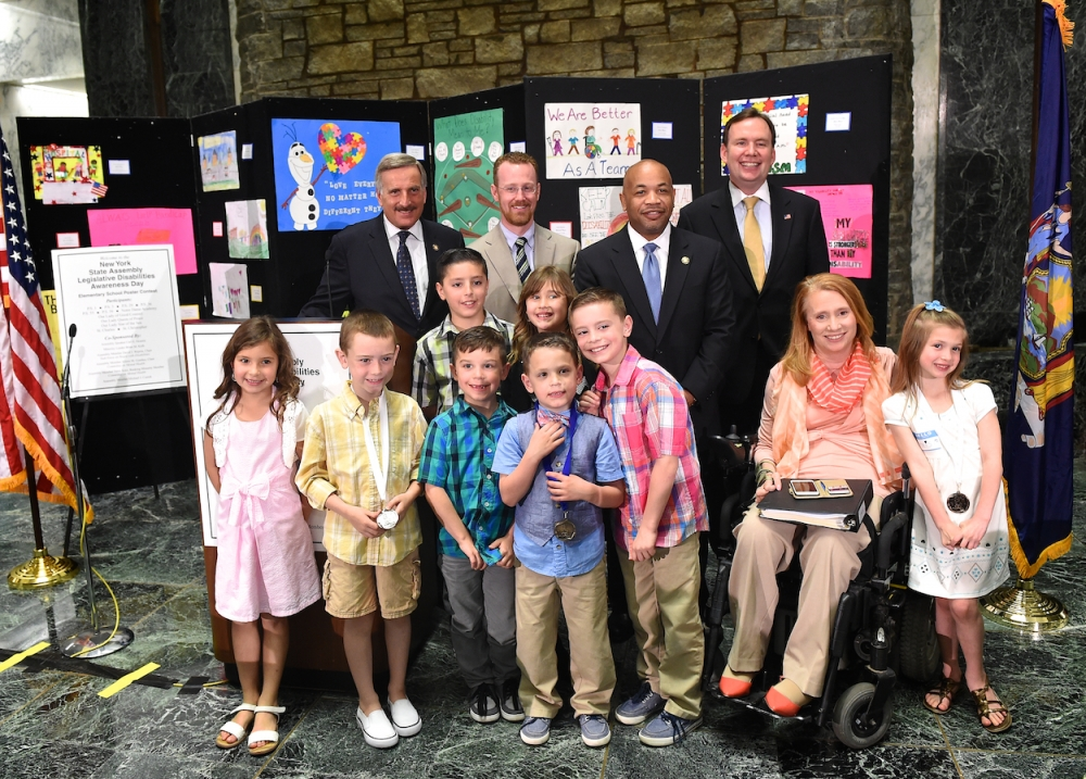 Assemblyman Mike Cusick, along with Assemblyman David Weprin, Chair of the Assembly Task Force on People with Disabilities, Speaker Carl Heastie and Kim Hill, Executive Director of the Assembly Task Force on People with Disabilities pose with Staten Island Disabilities Awareness Day Poster contest winners and their siblings at the State Capital. Student winners wearing their medals from left to right: Marcello Squarciafico, P.S. 1 (2nd grade, 3rd place); Rocco Dembinski, Our Lady Queen of Peace (Kindergarten, 1st place); Ryann Parcell, Notre Dame Academy (3rd grade, 2nd place); Alexis Gardella, St. Christopher (1st grade, 3rd place).