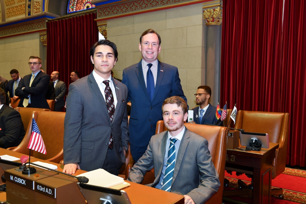 "Assemblyman Cusick attends the 2017 ""Intern Mock Session"" in the Assembly Chamber with his Interns, Matthew Rosenberg from the College of Staten Island and Luke Foley from the University Col"