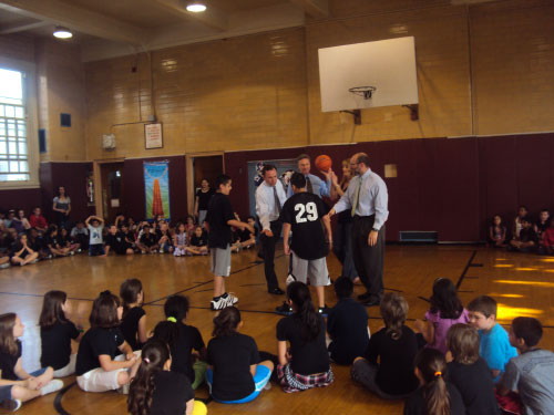 Assemblyman Cusick, along with partners of the TFC and the students of PS 29, playing basketball at the Total Fitness Challenge Kickoff.