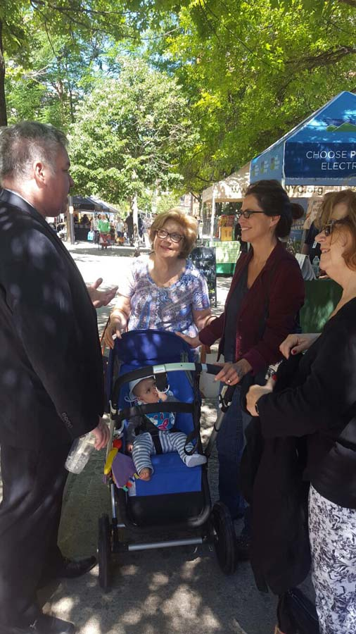 Assemblymember O'Donnell converses with constituents at a Farmers Market in the district.