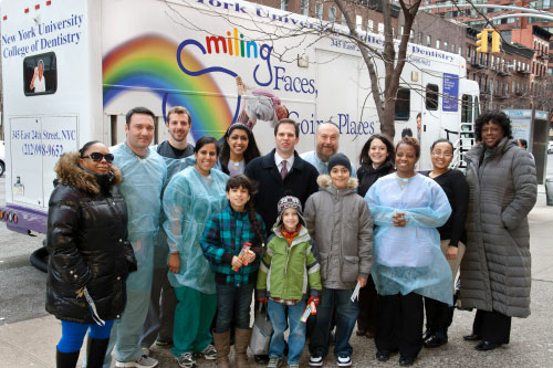 Principal Roebuck and her students from PS 198 standing with me and the great people who made the NYU College of Dentistry free mobile dental van possible.