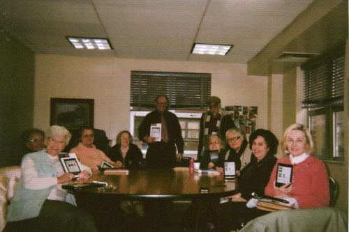 The folks at Stanley Isaacs book club receiving their new tablet readers that the Assembly Member and New York Public Library helped provide.
