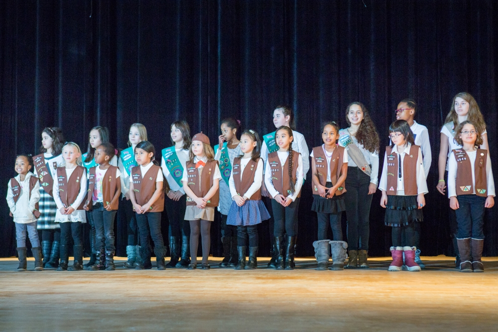 February 22�Julia Richman High School, UES� Roosevelt Island Girl Scout Troops 3001, 3244 and 3245 lead the crowd in the Pledge of Allegiance at the inauguration ceremony of Assembly Member Rebecca Seawright.
