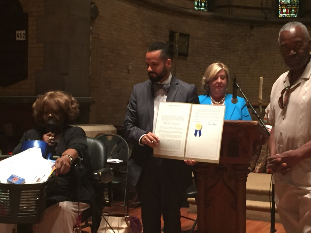 August 5, 2015� Chapel of the Good Shepherd, Roosevelt Island ---State Senator Serrano presents the official proclamation inducting former Roosevelt Island Resident, Dominic Sciallo, into the 2015 NYS Senate Veterans Hall of Fame.