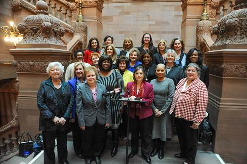 Assembly Member Seawright stands with the Members of the New York State Legislative Women's Caucus (LWC) at a press conference to outline the group's priorities for the 2016 session. A poll of the members resulted in quality, affordable child care, after school programming, and the 100th anniversary of women's suffrage in New York being chosen as the three topics of focus this year.