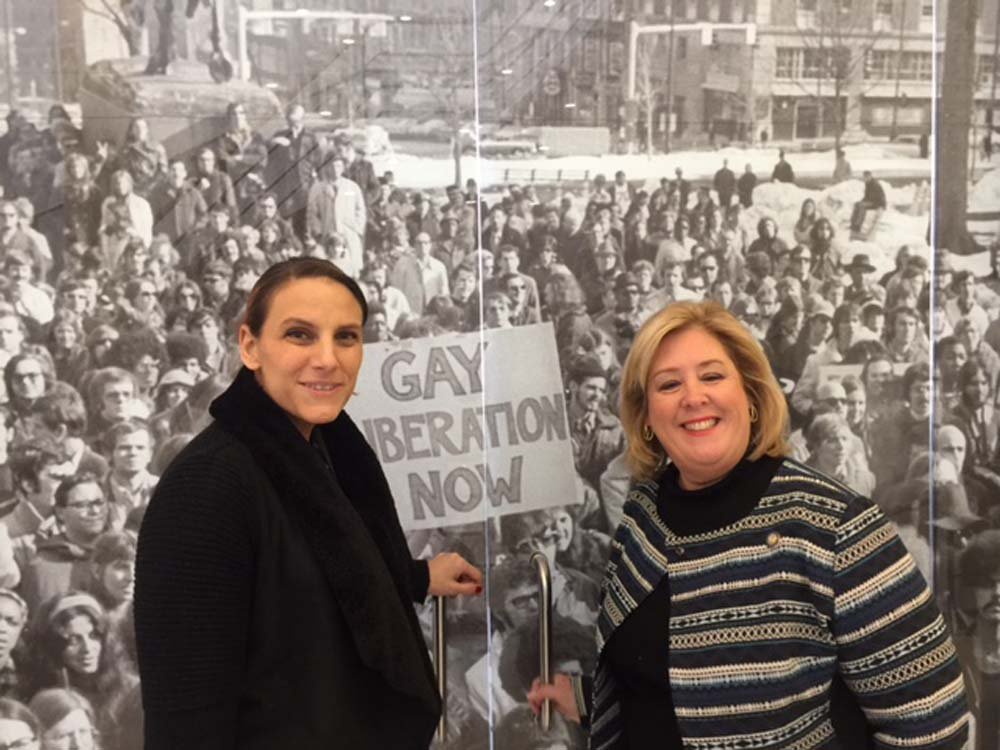 March 9, 2017 – On Thursday, March 9, 2017 Assembly Member toured The Lesbian, Gay, Bisexual & Transgender Community Center that provides family, community, youth and wellness services to individuals from across the five boroughs. The Center is visited by 6,000 people every week. Last week, Assembly Member Seawright joined her colleagues in the Assembly and signed a letter to the Speaker asking that $200,000 be allocated in the State budget for The Center's economic justice program. It is located at 208 West 13th Street, Manhattan.<br />Glennda Testone, The Center's Executive Director, and Seawright discuss the photo of the gay rights demonstration in Albany, New York, 1971.<br />