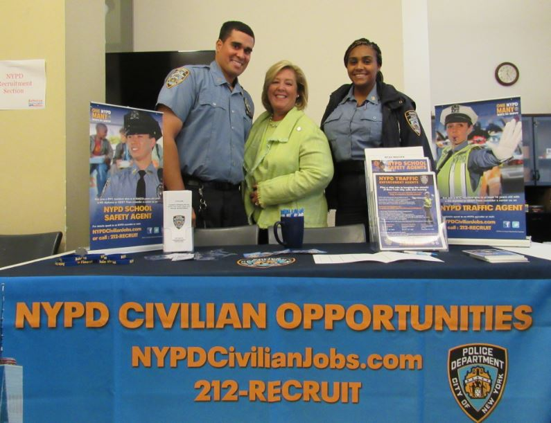 Seawright with NYPD officers offering civilian opportunities to become safety and traffic agents.<br />