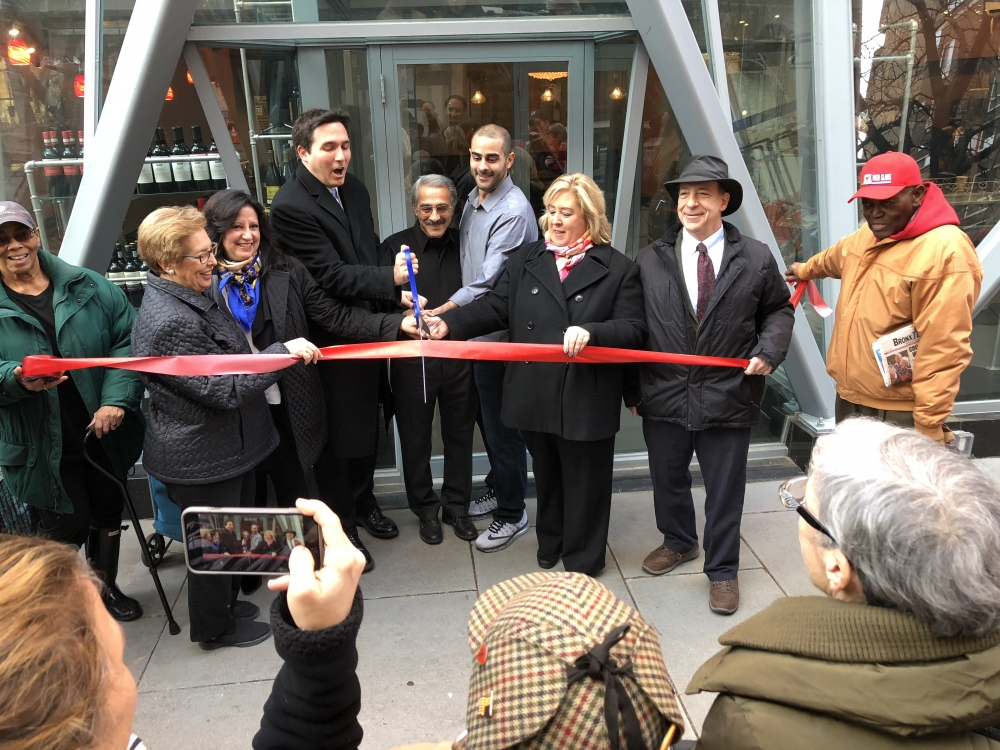 Roosevelt Island Historian Judy Berdy, Council Member Ben Kallos, Nisi owners Kai and Alex Razaghie, Assembly Member Rebecca Seawright, RIOC Board Member Howard Polivy and Frank Gibbs help to cut the ribbon for the New Restaurant Nisi.  Seawright assisted Mr. Razaghie in getting the necessary fire inspections for the opening.<br />