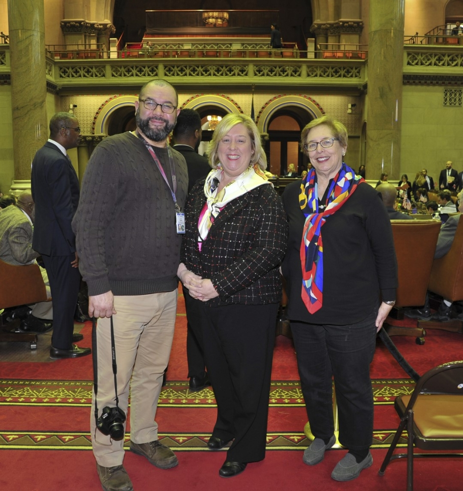 Roosevelt Island Coler Hospital Public Affairs Rep. Jose Torres, Assemblymember Rebecca Seawright, and Roosevelt Island Historical Society President Judy Berdy in the chamber.