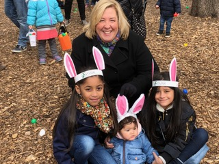 Sunday, March 25, 2018 – Carl Schurz Park, Upper East Side – Eggs to Go: Assembly Member Rebecca Seawright with three of hundreds of children who enjoyed the annual Carl Schurz Park Conservancy Easter Egg Hunt‎ yesterday. Thirty-six thousand eggs were available to the eager young hunters, bringing joy and good cheer to the holiday season.<br />