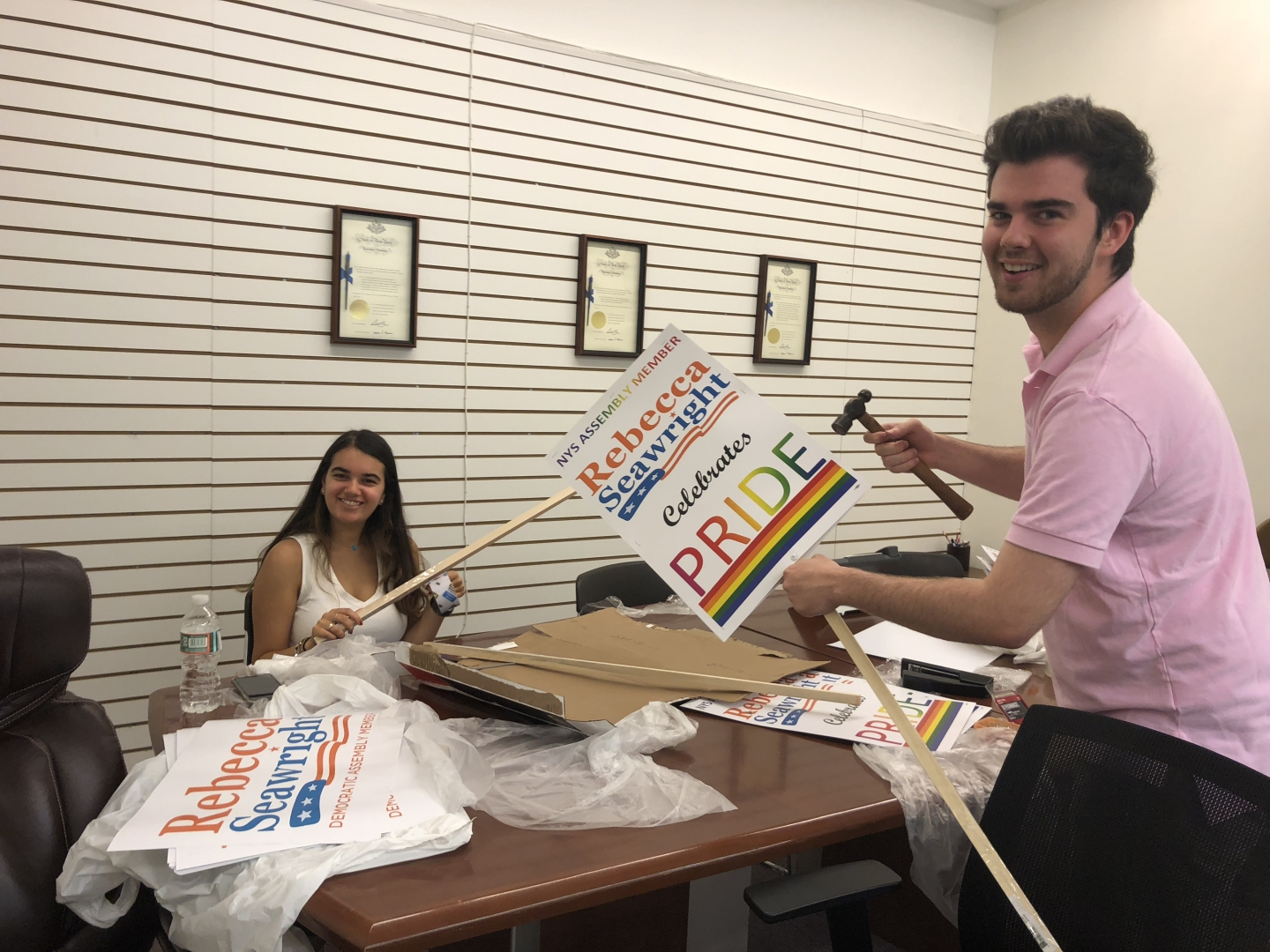 Carly Deitelzweig and Luke Spellman prepare signs for the Pride March on Sunday!<br />&nbsp;