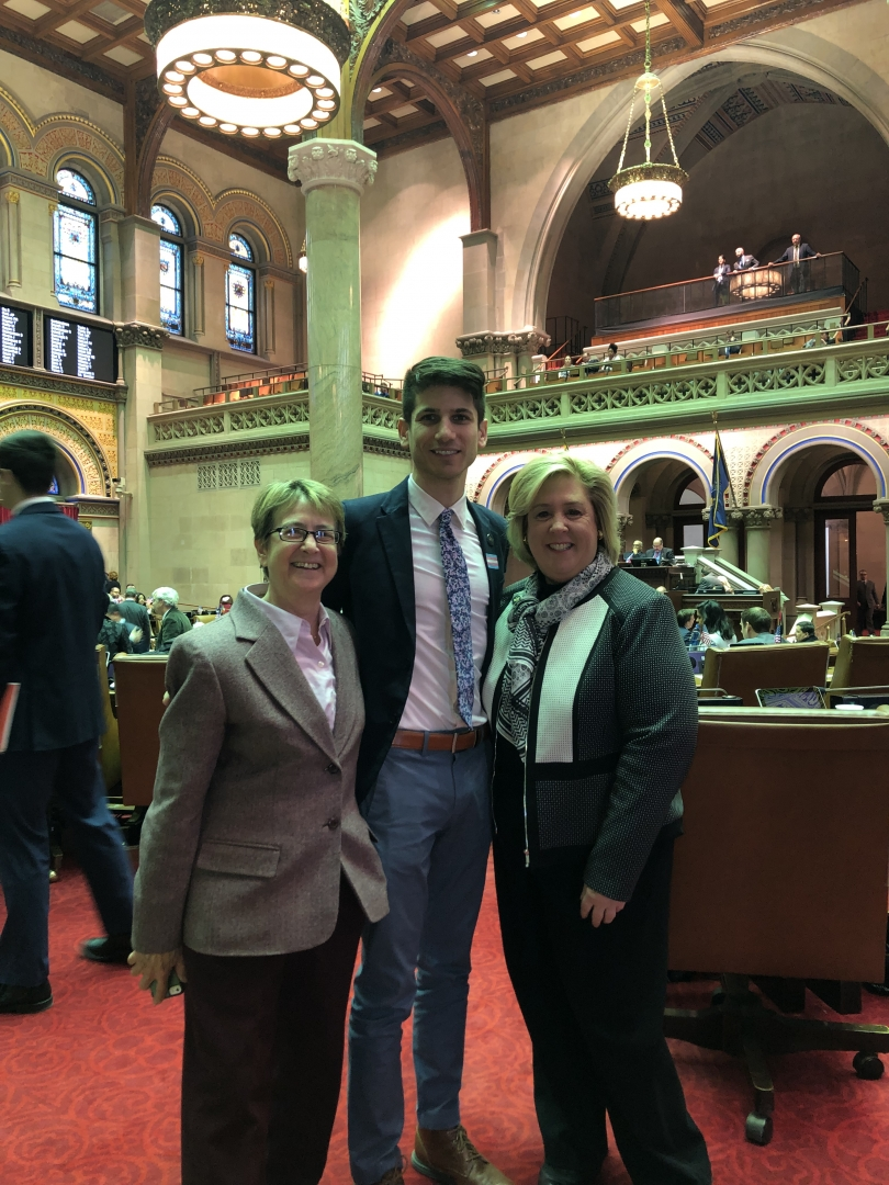 Assembly Member Deborah Glick, Equality NY's Gabriel Blau, and Assembly Member Rebecca Seawright after the passage of GENDA and a bill banning conversion therapy in New York State.
