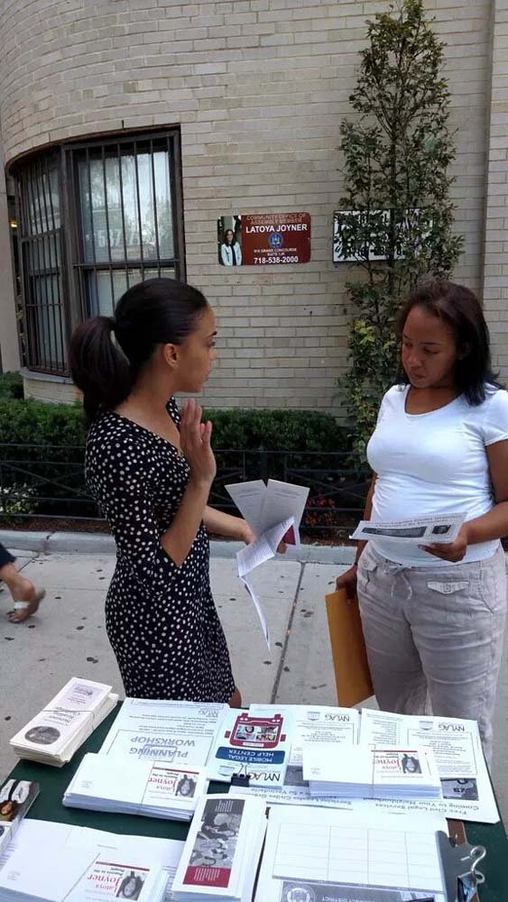 Assemblywoman Latoya Joyner speaks to a constituent in front of her Community Office, located at 910 Grand Concourse, between E. 162 and E. 163rd Street.