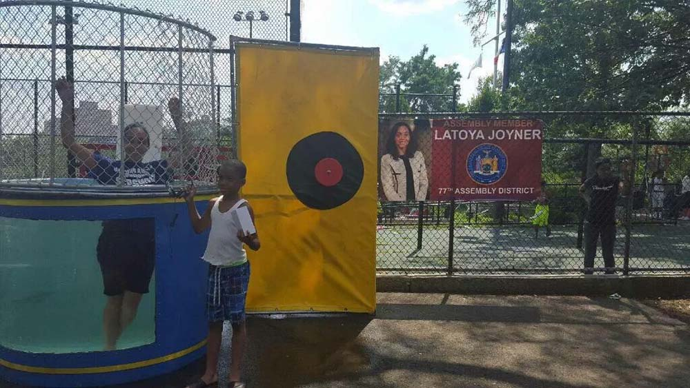 Focusing on supporting the long standing tradition of Family Day at Sedgwick Houses, Assemblywoman Latoya Joyner sacrificed herself by participating in her first ever �Dunk the Assemblywoman� event.