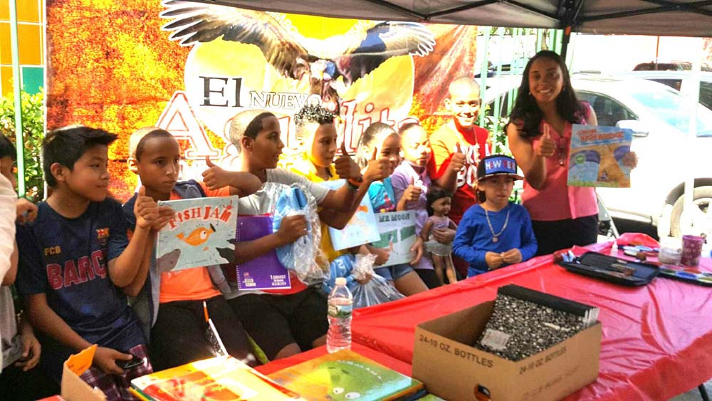 Assemblywoman Latoya Joyner joins children on Ogden Avenue for a Back-to-School event for the community.<br />