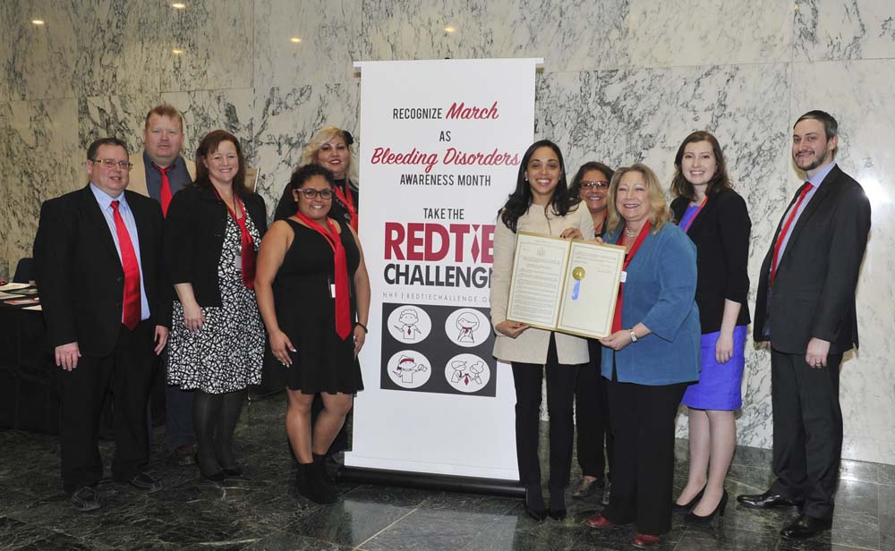 Assemblywoman Latoya Joyner presents her resolution to members of the Bleeding Disorders Association of Northeastern New York, which declares March as Bleeding Disorders Awareness Month in New York State.<br />