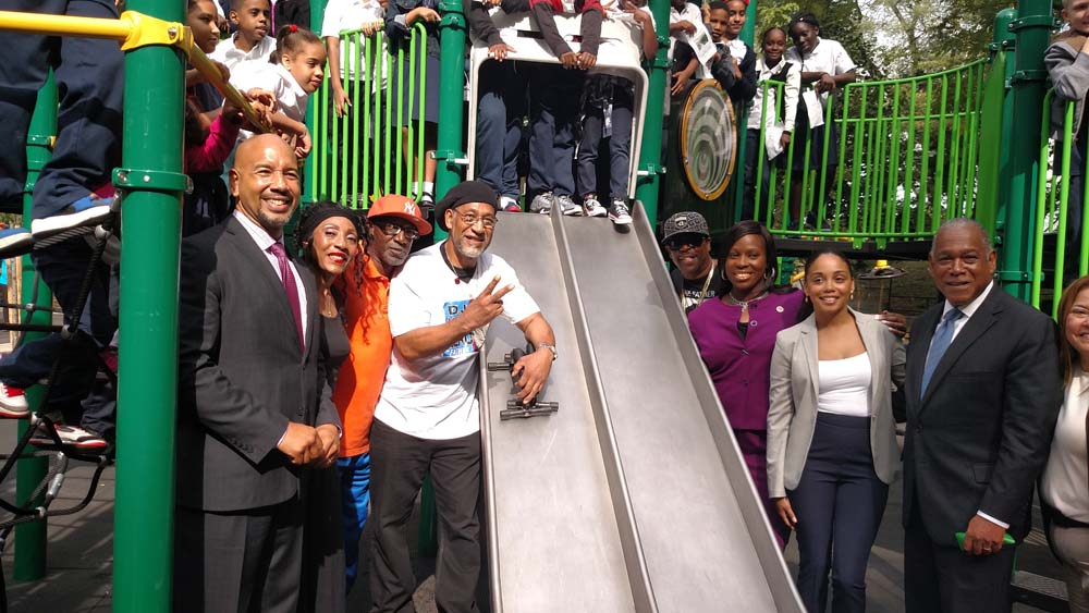 Assemblywoman Latoya Joyner joins her colleagues and NYC Parks Commissioner Mitchell J. Silver to announce the revitalization of Cedar Playground.
