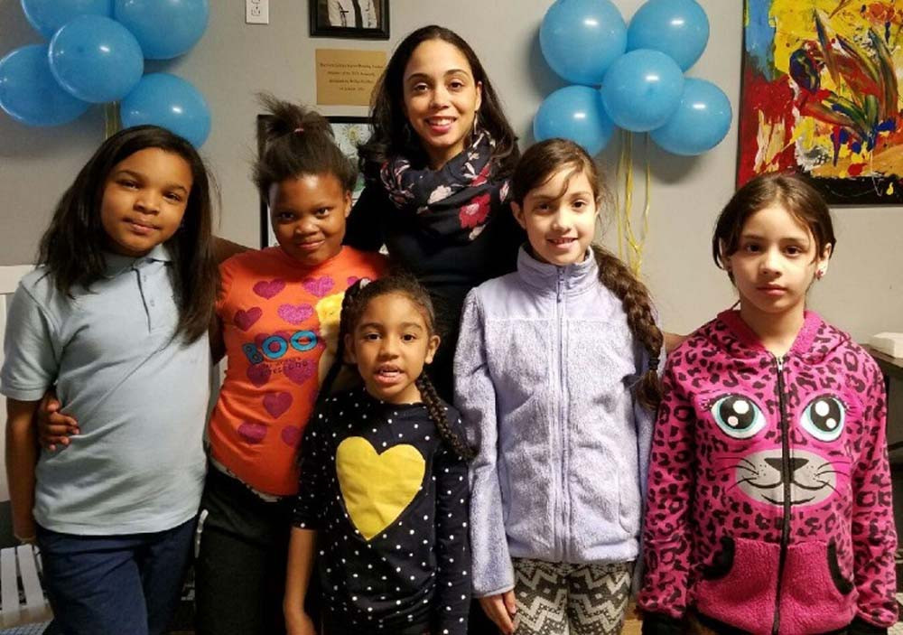 Assemblywoman Latoya Joyner with local children during the unveiling of Bridge Haven Family Shelter's new Family Literacy Program.