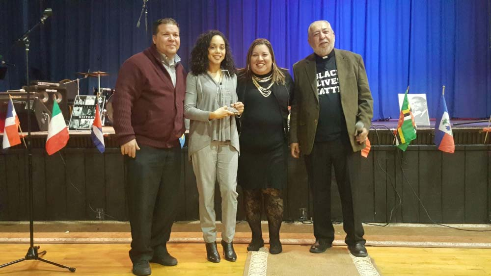 Assemblywoman Latoya Joyner is honored by Rev. Dr. Raymond Rivera and the Latino Pastoral Action Center during their Black History Month celebration.