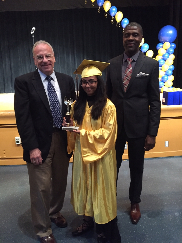 Assemblyman Dinowitz attending the June 23rd Graduation Ceremony of PS 95 pictured presenting the Community Service Award to Jada Singer.