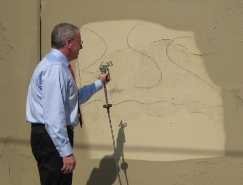 Assemblyman Jeffrey Dinowitz has long been a fighter against the scourge of graffiti. He is shown here spraying away graffiti on a wall at PS 24. His anti-graffiti program is funded through money he secured from the state for KRVCDC.