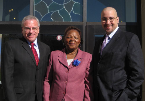 Assemblyman Jeffrey Dinowitz and newly elected State Senator Gustavo Rivera are shown here with community leader Sallie Caldwell, at the annual breakfast of the Precinct Community Council at Lehman College.