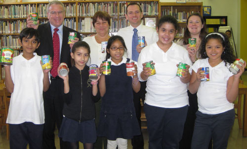 Assemblyman Jeffrey Dinowitz visited P.S. 7 in Kingsbridge where he is pictured with Principal Frank Patterson, Tara McMaster, Kelly Links, and student government leaders who are holding cans of food at the school library. The school collected hundreds of pounds of food for Assemblyman Dinowitz�s canned food drive. The food was donated to the Kingsbridge Heights Community Center and the food pantry at Saint Francis of Rome Church in Wakefield for families in need.