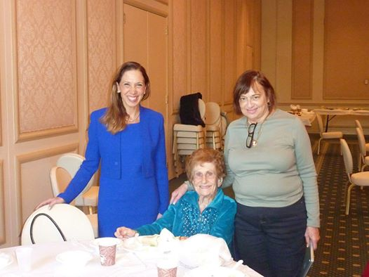 Assemblywoman Amy Paulin gave out holiday cookies to the seniors at Temple Beth-El in New Rochelle. That�s 100-year-old Tilly Auerrabach seated next to her.