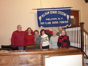 Amy Paulin hands out holiday cookies in Pelham and swears in the new board members of the Pelham Senior Citizens group.