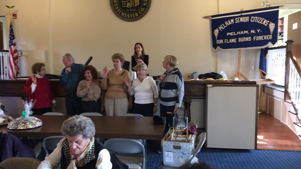 Assemblywoman Amy Paulin handed out holiday cookies to the Pelham Seniors Organization and then swore in the new officers for 2017.