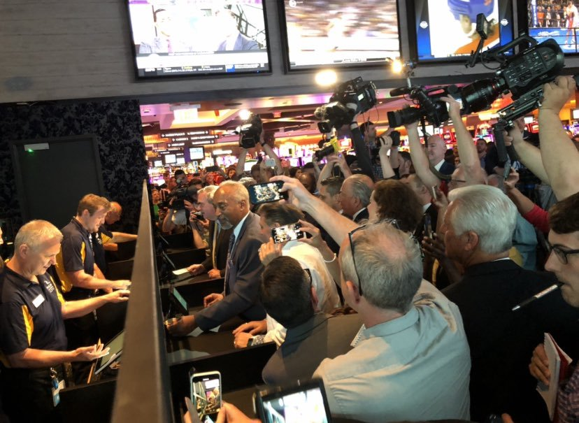 Assemblyman J. Gary Pretlow the Racing and Wagering Chair makes the first legal sports bet in New York at Rivers Casino & Resort sports book opening in Schenectady, New York.