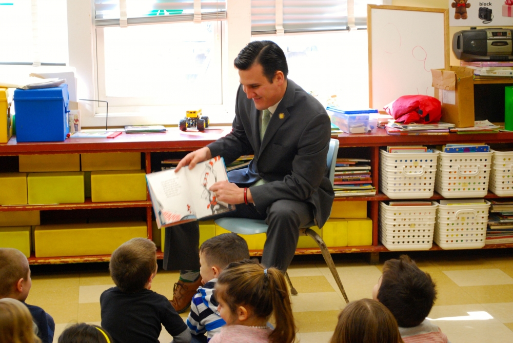 The photo attached depicts Assemblyman Kevin Byrne (R,C,I,Ref-Mahopac) reading Dr. Seuss' The Cat in the Hat Comes Back, to a group of nursery school students at the Carmel Nursery School. Byrne is participating in Read Across America's initiative to bring reading excitement to children of all ages and encourage students to engage in reading.<br />
