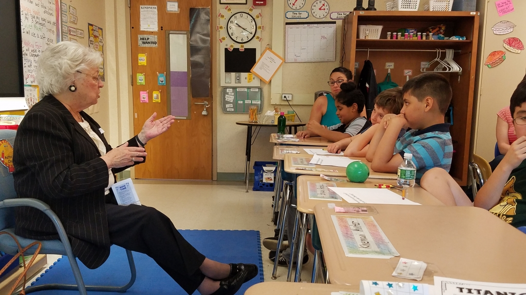 Sandy visited elementary students in their classroom to talk about how the government works, and how a bill becomes a law.