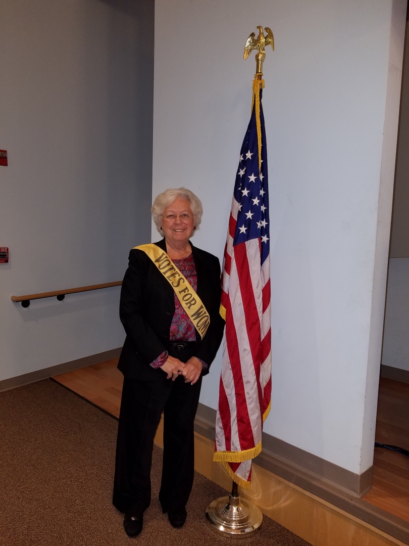 We are currently celebrating the 100th anniversary of women's suffrage in New York State. Sandy had the opportunity to try on an authentic sash worn by a suffragist during the movement.