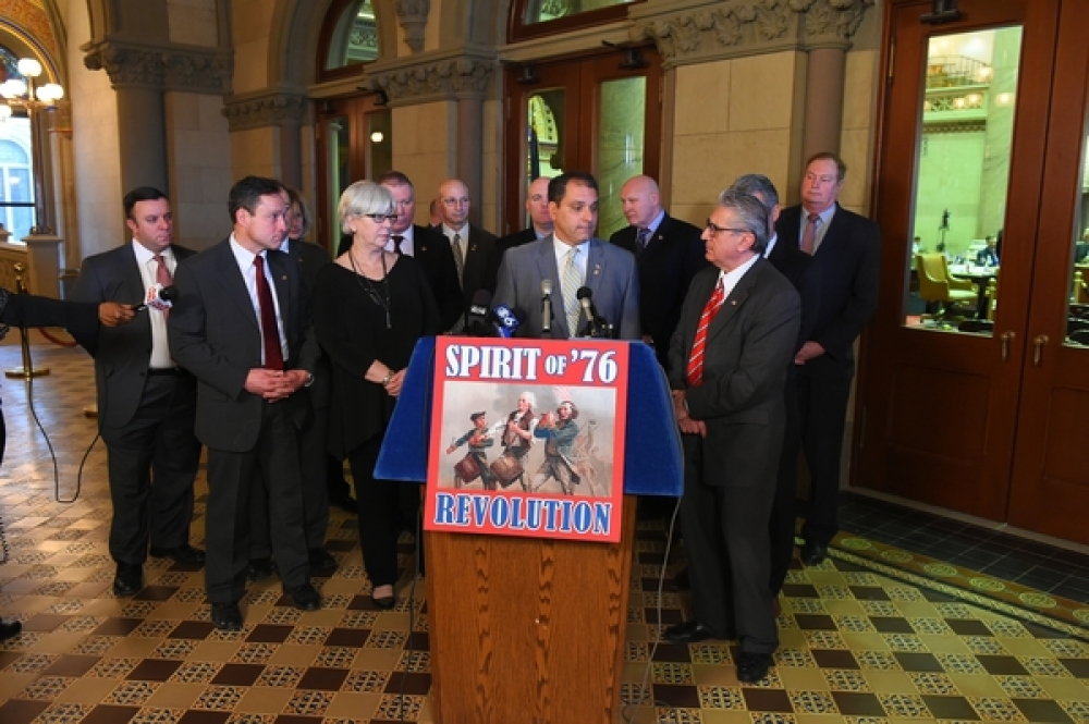 "Assemblyman Karl Brabenec (R,C,I-Deerpark) (far left) at a press conference in Albany recently to support the ""Spirit of '76"" bill. This legislation would allow bills with at least 76 sponsors to automatically come before the Assembly Chamber for a vote."