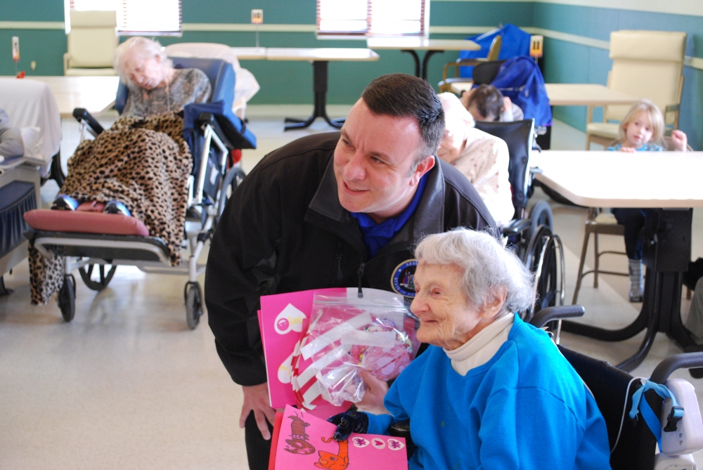 Assemblyman Karl Brabenec (R,C,I-Deerpark) pictured presenting Valentine's Day cards to a resident of the Schervier Pavilion Nursing Home in Warwick recently.