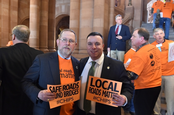 Assemblyman Karl Brabenec (R,C,I-Deerpark) poses next to a local highway supporter at today's press conference