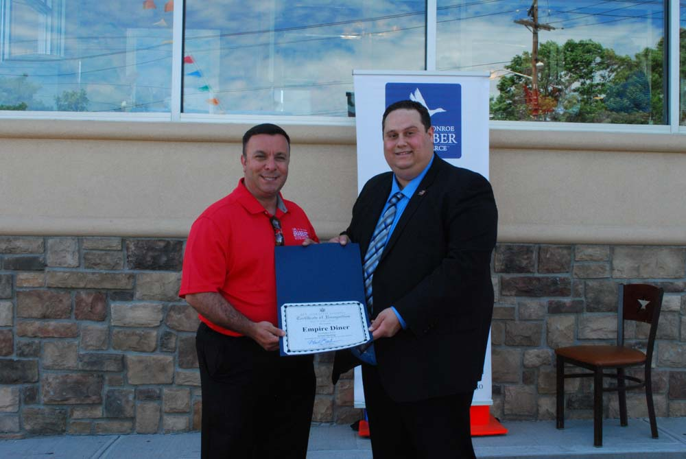 Assemblyman Karl Brabenec (R,C,I-Deerpark) presents a Certificate of Recognition Empire Diner's new owner David Wenger