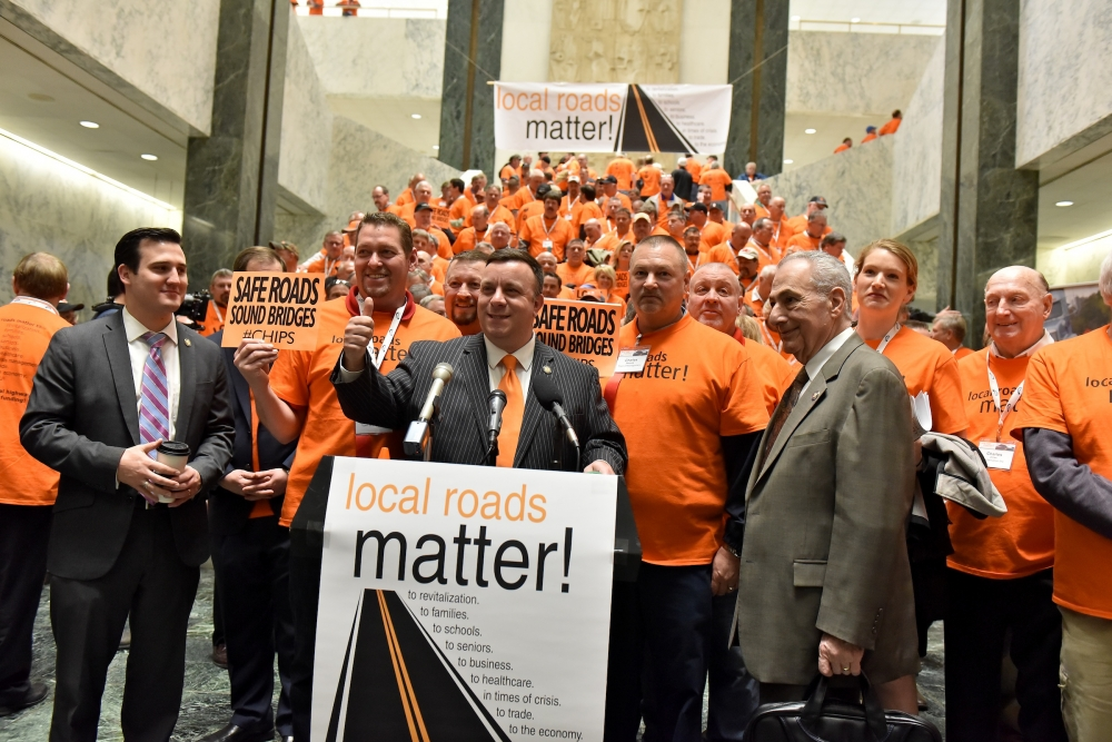 Assemblyman Karl Brabenec (R,TCN-Deerpark) [at podium] today joined legislators and construction workers at an Albany rally to call for increased funding for local roads and highways.<br />