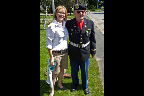 Aileen with a veteran at the Trout Town USA celebration in Roscoe.