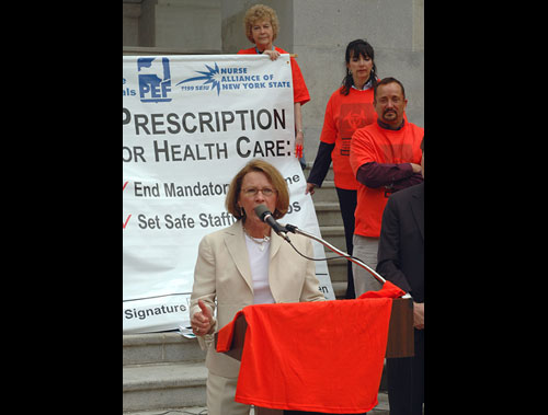 Assemblywoman Aileen Gunther speaks to nearly 200 nurses from across New York State who rallied at the Capitol in favor of legislation that will end mandatory overtime and create safe staffing levels at our hospitals. Gunther, a nurse for over 29 years and a member of the Assembly Health Committee is advocating for passage of these measures so that our nurses, the first line of defense, have the tools they need to provide our families with quality care.