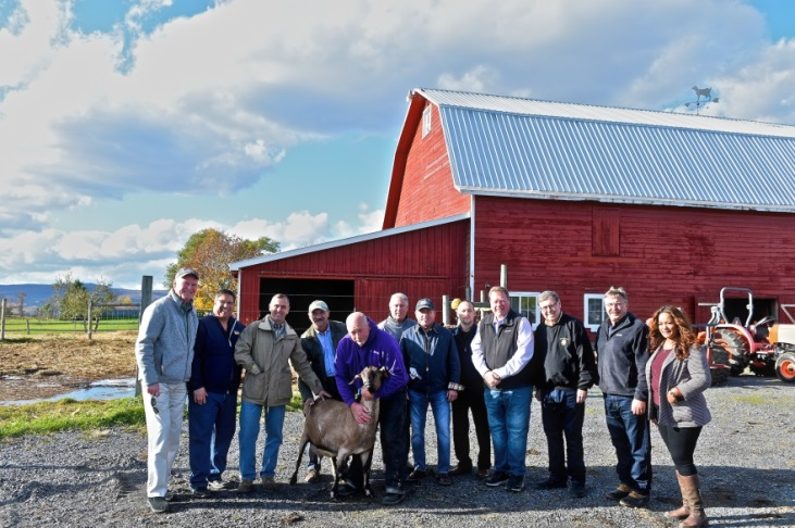 Assemblyman Chris Tague (R,C,I,Ref-Schoharie) alongside members of the Assembly and Senate at Beekman Boys Farm in Schoharie County on Wednesday, October 23.