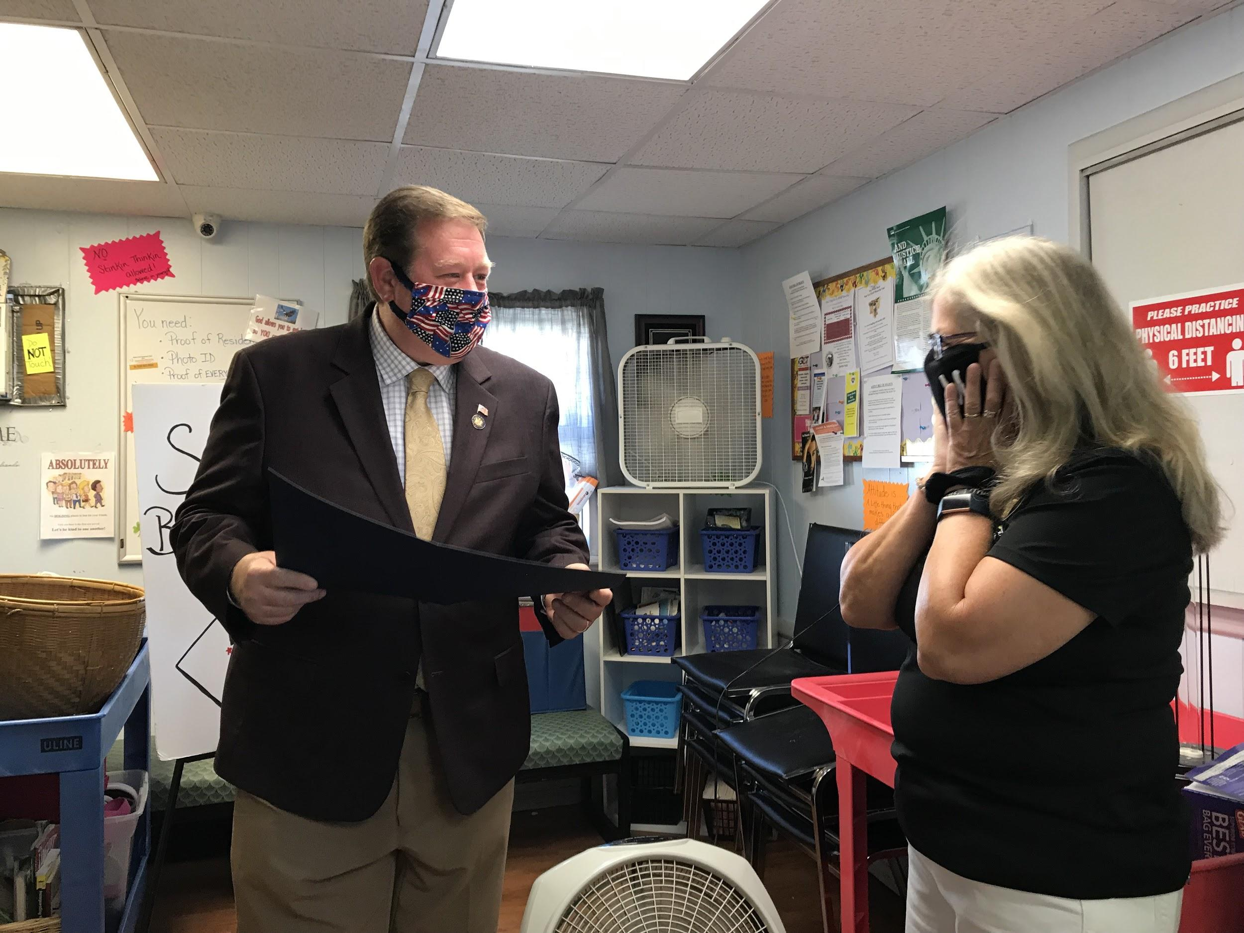 Assemblyman Chris Tague (R,C,I,Ref-Schoharie) presents Patti Dushane with legislative resolution on Wednesday, August 5th.