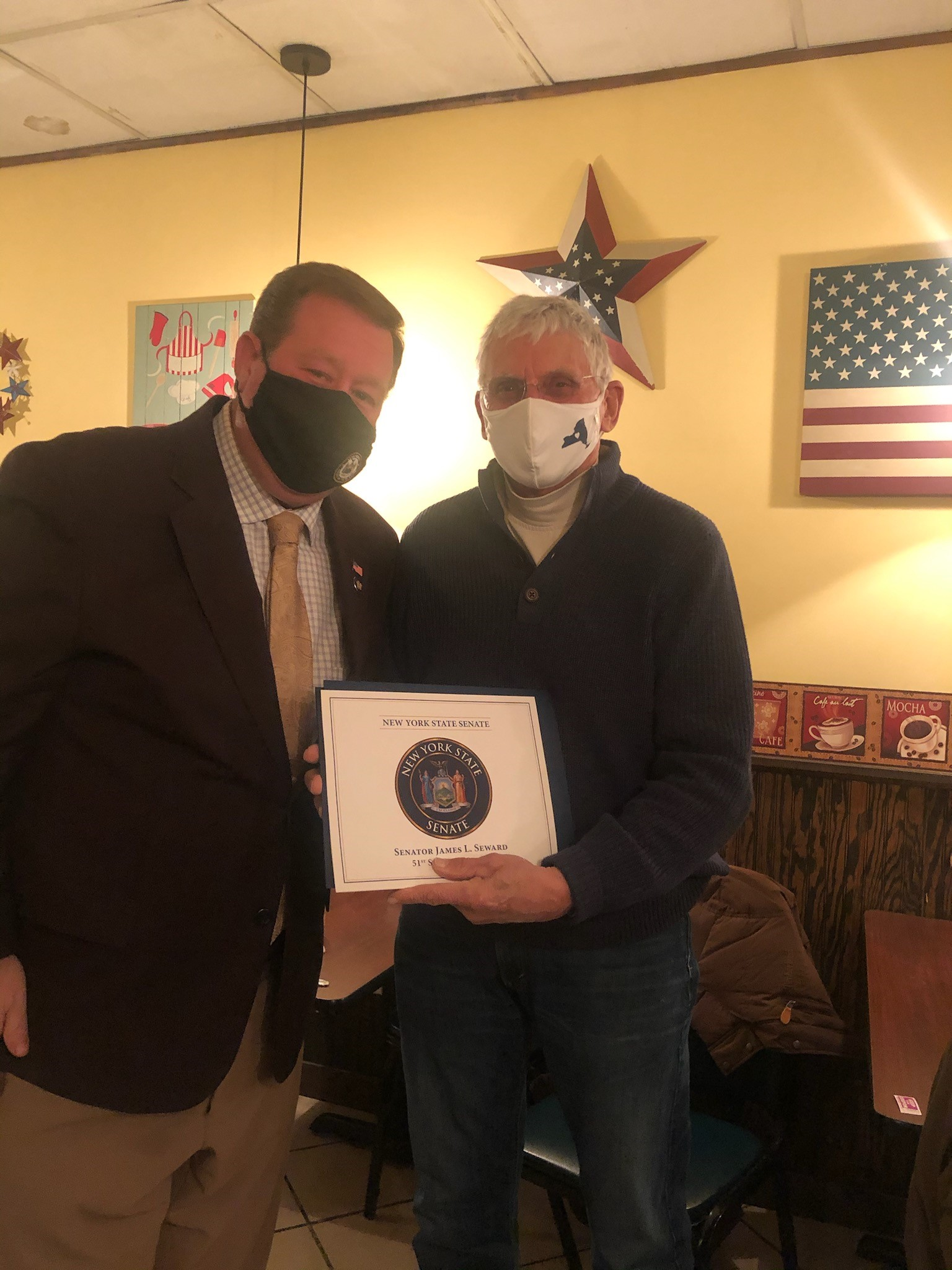 Assemblyman Chris Tague (R,C,I,Ref-Schoharie) presents Bruce Palmatier with an Assembly Citation as well as recognitions from the New York State Senate and United States House of Representatives on be