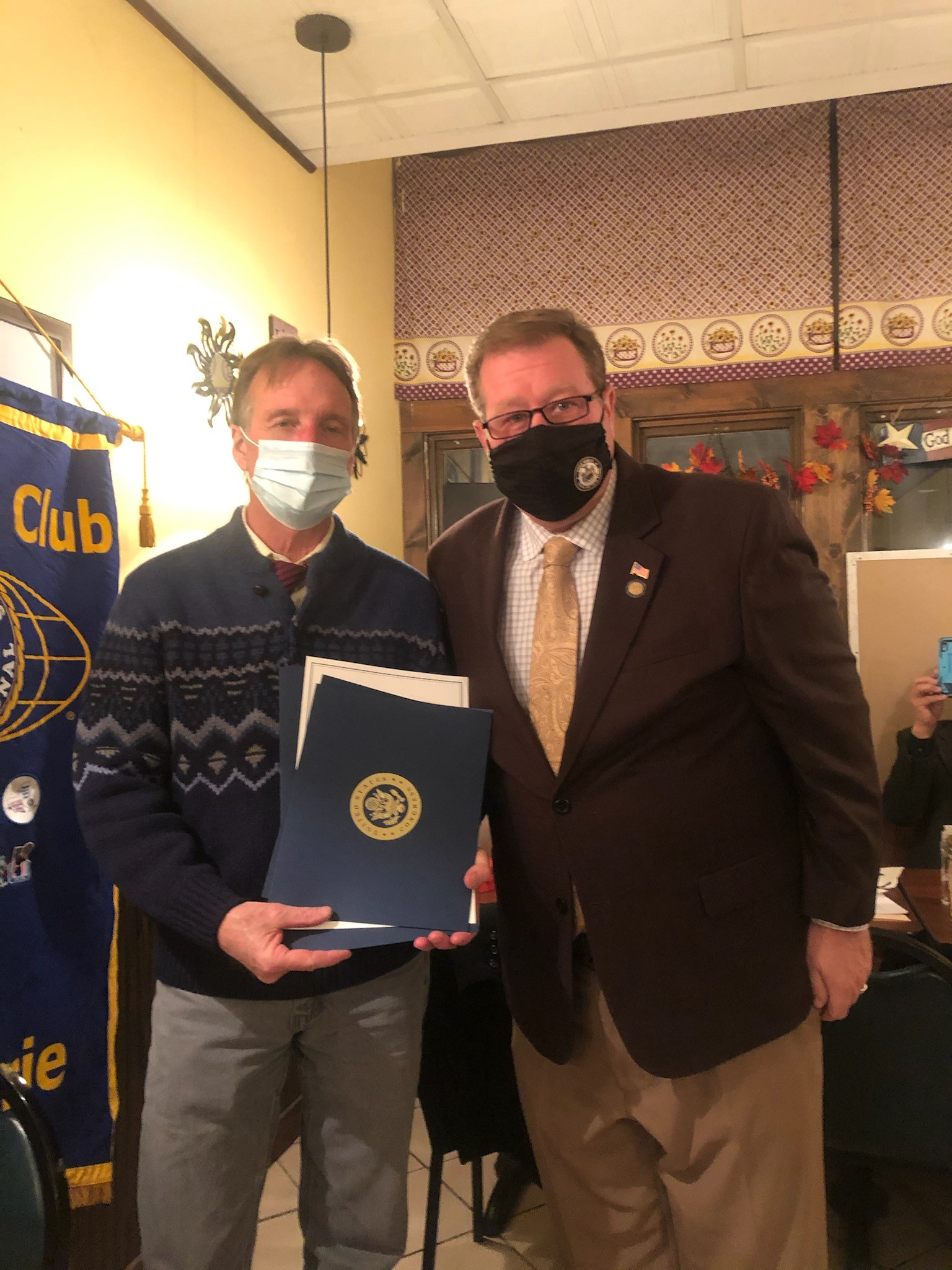Assemblyman Chris Tague (R,C,I,Ref-Schoharie) presents Kiwanis Vice President Michael Langan with an Assembly Citation as well as recognitions from the New York State Senate and United States House of